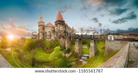 Beautiful spring panorama view of the Corvin Castle, also known as Hunyad Castle or Hunedoara Castle is a Gothic-Renaissance castle in Hunedoara, in the region of Transylvania, Romania at sunset