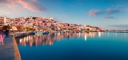 Beautiful spring seascape on Aegean Sea. Colorful evening panorama of Kavala city, the principal seaport of eastern Macedonia and the capital of Kavala regional unit. Greece, Europe.