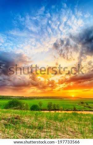 Beautiful spring sunset over pond on the plain #197733566