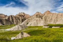 beautiful springtime landscape of the Badlands in south dakota with spring green grass