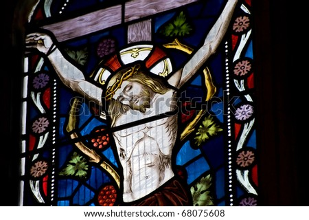 Beautiful stained glass window depicting Jesus on the crucifix