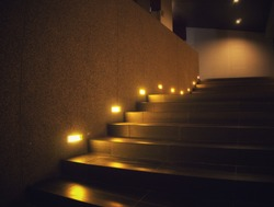 beautiful stair steps with yellow light in the night time