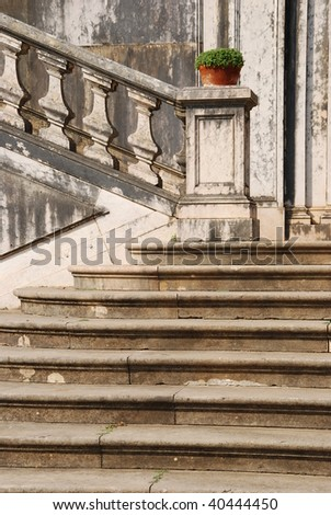 beautiful staircase at a local garden with a flower vase and stone steps
