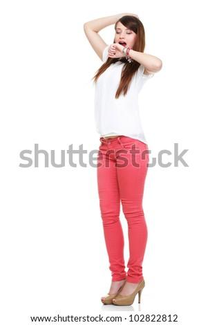 Beautiful standing yawning stretching woman in red Studio shot.