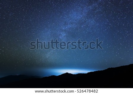 Beautiful star on night sky and Bright cloud over the mountain. Background