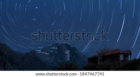 Beautiful star trail with mountains. Tosh Village.