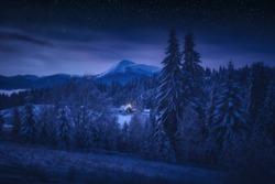 Beautiful starry night landscape of Ukrainian Carpathians. Frozen winter in a highlands, Europe travel, beauty world, Happy New Year, Marry Christmas.