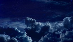 beautiful starry night sky with large clouds
