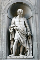Beautiful statue of Nicola Pisano outside of the Uffizi Gallery florence , Famous Italian artist  sculptor whose work is for  classical Roman sculptural style.
