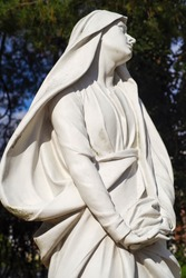 Beautiful statue of the Virgin Mary with a billowing veil.
