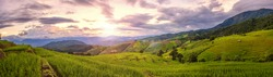 Beautiful step of rice terrace paddle field in sunset and Lens Flare with Panorama View at Chiangmai, Thailand. Chiangmai is beautiful in nature place in Thailand, Southeast Asia. Travel concept.