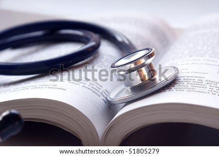 Beautiful stethoscop on book - stock photo