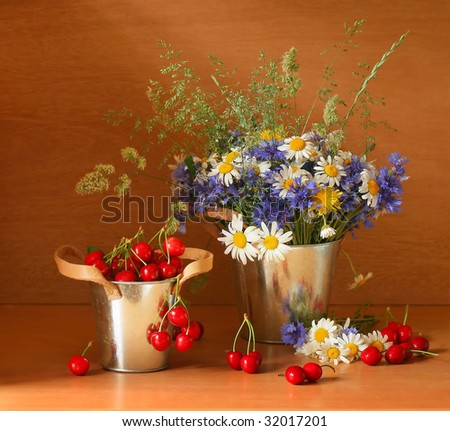 Beautiful still life with cherries and fresh flowers