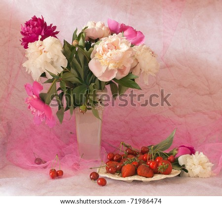 beautiful still life with fresh berries and peonies