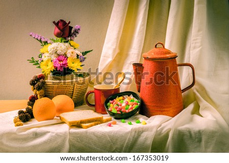 Beautiful still life with vintage basket and flowers