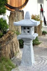beautiful stone shrine lanterns in a Japanese garden