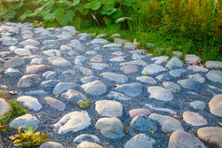 Beautiful stone walkway in the park closeup.