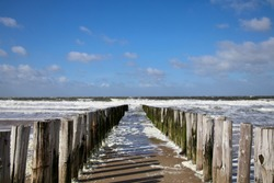 Beautiful stormy day at sea. Waves clouds and seafoam. Westkapelle, zeeland. Springbreak