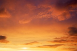 Beautiful stormy sunset sky. Cloudy abstract background. Sunset colors.