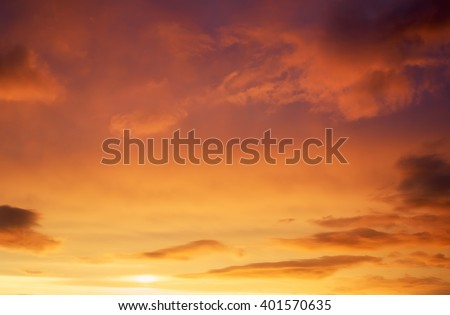 Beautiful stormy sunset sky. Cloudy abstract background. Sunset colors. #401570635