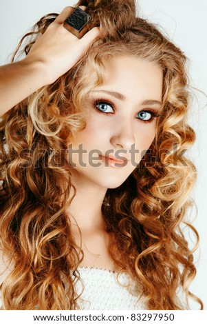 D.Gray-man RP Stock-photo-beautiful-strawberry-blond-woman-with-blue-eyes-and-long-big-curly-hair-with-hand-in-hair-83297950