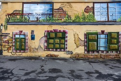 Beautiful street art graffiti. Abstract creative drawing fashion colors on the walls of the city. Urban Contemporary Culture. The word