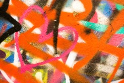 Beautiful street art graffiti. Abstract creative drawing fashion colors on the walls of the city. Urban Contemporary Culture. Art underground. The wall is decorated with abstract drawings house paint.