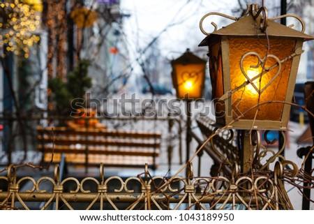 Beautiful street lanterns illuminated at night #1043189950