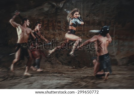Stock Photo Beautiful strong girl gladiator with sword fights a warrior. Ancient Rome