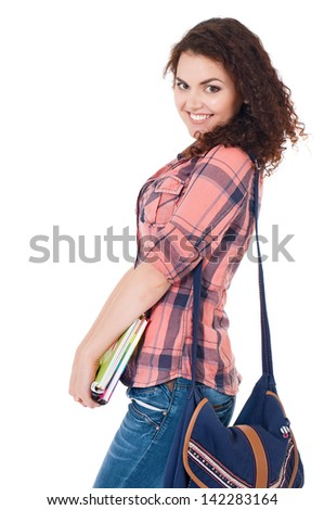 Beautiful student girl with bag and exercise books, isolated on white background