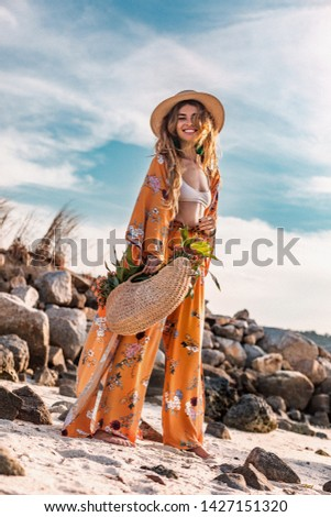 beautiful stylish boho model having fun  outdoors at sunset