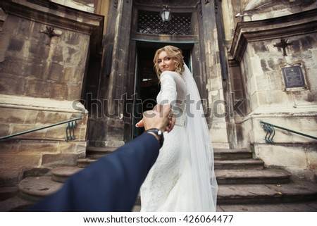 beautiful stylish bride leading ...