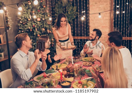 Beautiful stylish classy elegant cheerful attractive people sitting at dinner table, slim gorgeous girl serving homemade bakery, house festive, guys applausing #1185197902