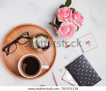 Beautiful stylish femine items: gold glips, candle, notepads, coffe and roses. Top view. #781921138