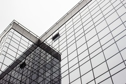 beautiful stylish urban geometric gray and black building of glass, business and future concept