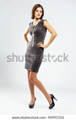 Beautiful stylish woman in elegant grey dress