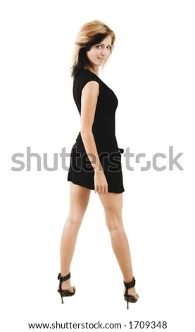 Beautiful stylish woman posing in a cute black dress - isolated on white - very high resolution