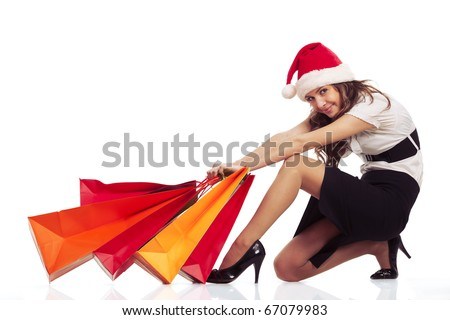 Beautiful stylish woman pulling christmas shopping bags