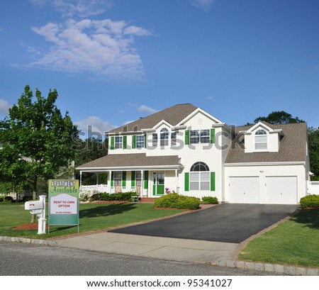 Beautiful Suburban Home with Apartment For Rent and Rent to Own Sign on Landscaped Front Yard Lawn in Residential Neighborhood on sunny blue sky day