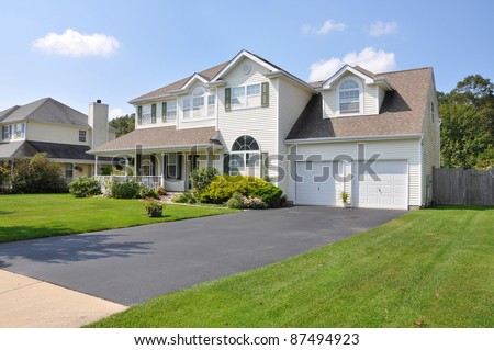 Beautiful Suburban Split Level McMansion Home Two Car Garage in Residential Neighborhood