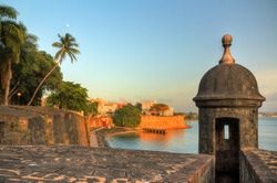 Beautiful summer afternoon at the outer wall with sentry box of fort San Felipe del Morro in old San Juan in Puerto Rico