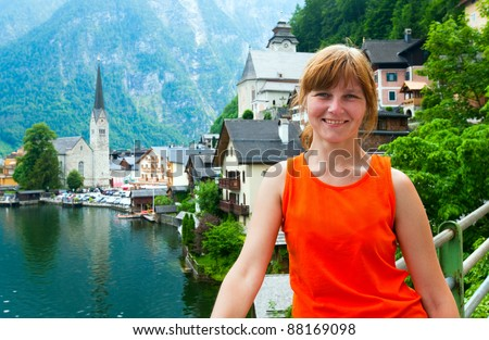 Beautiful summer Alpine Hallstatt Town and lake view (Austria) and woman - tourist