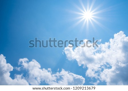 Beautiful summer background with sunlight and clouds on blue sky. #1209213679