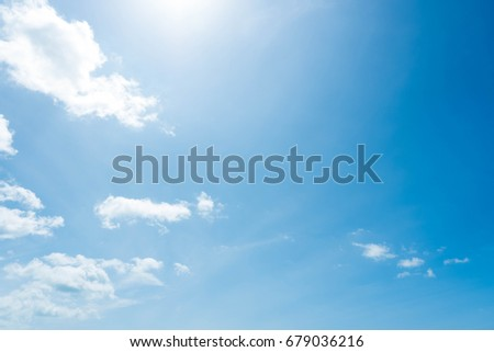 Beautiful summer blue sky and white fluffy clouds with sunlight in afternoon. - Shutterstock ID 679036216