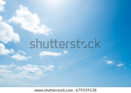 Beautiful summer blue sky and white fluffy clouds with sunlight in afternoon. - Shutterstock ID 679339138