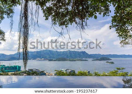 Beautiful Summer Day in Tolo Harbor Area next to the Chinese University of Hong Kong. Tsz Shan Monastery is located on these mountains.