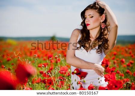 beautiful summer girl  in a poppy field