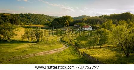 Beautiful summer landscape at sunset. Village near town of Valjevo, western Serbia.