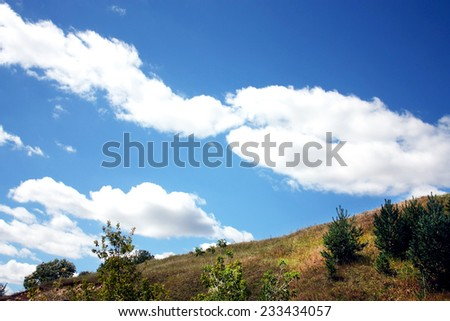 Beautiful summer landscape-horizon line between the sky and the mountain terrain