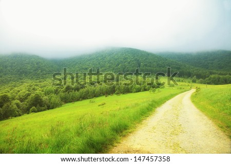 Beautiful summer landscape in the mountains. Pathway through the grassy hills Bieszczady Poland
